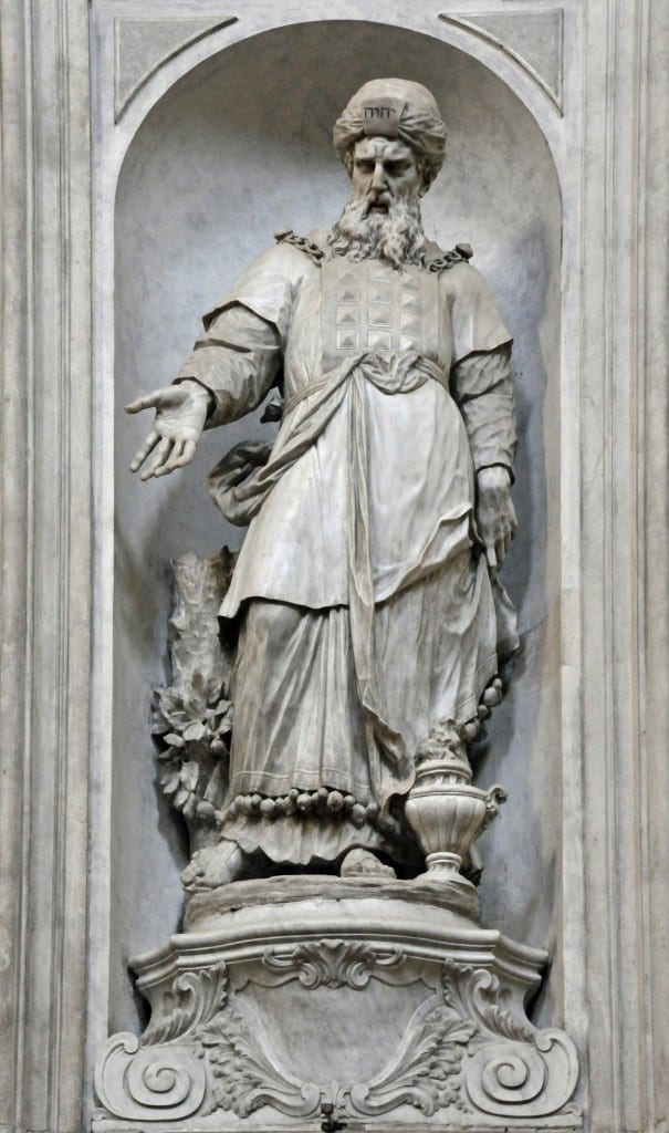 "In this sculpture in the Santa Maria del Rosario Church in Venice, Italy, Aaron is depicted wearing the priestly breastplate with the gems arranged in four rows of three. ""Aaron by Giovanni Maria Morlaiter"" by Wolfgang Moroder is licensed under CC By-SA 3.0"