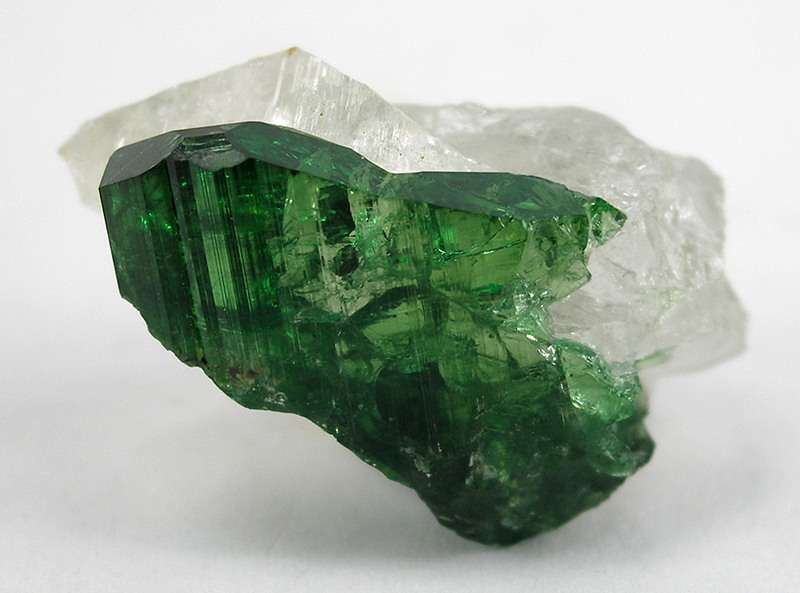 "Chrome tourmaline gets its intense green color from chromium. Grading faceted dark colored gemstones can present some challenges. A simple calculation can help you estimate a fair value for these beautiful stones. ""Chrome Tourmaline with Quartz"" © Rob Lavinsky, www.iRocks.com. Used with permission."
