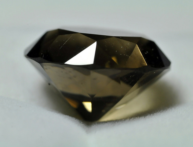 "Polishing girdles should be relatively easy if you can avoid some common mistakes. ""Cut Quartz 1,"" smoky quartz, by Sandy Chase is licensed under CC By 2.0"