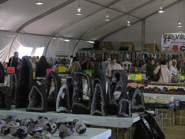 """Tucson Gem and Mineral Show,"" Tents at Tucson Electric Park, 2010, by Patrick Gibbons is licensed under CC By 2.0"