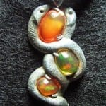 """Serpentine Fire Opal Pendant,"" Mexican fire opals and sterling silver, by Jessa and Mark Anderson is licensed under CC By 2.0"