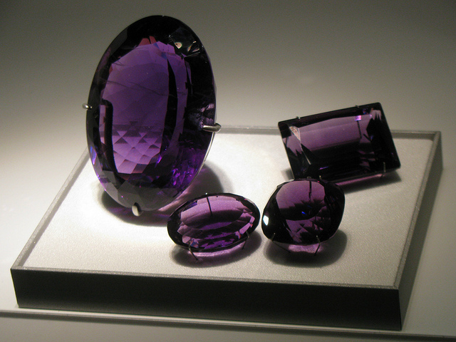 "Polishing gemstones can be one of the most difficult stages of faceting. Pre-polishing plays a major role in how well a gem can take a polish. ""Amethyst Gems"" by Eden, Janine and Jim is licensed under CC By 2.0"