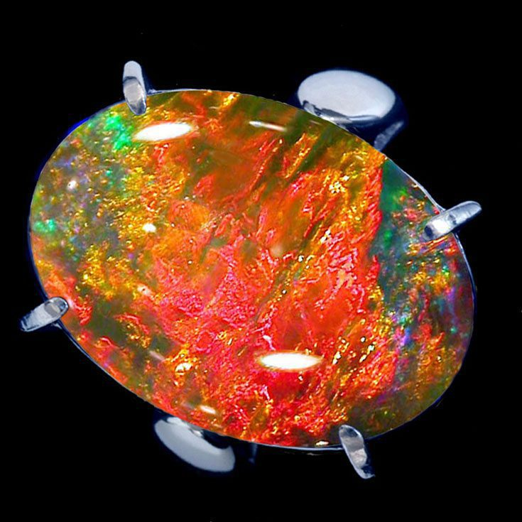 opal ring with play of colors - opal gems