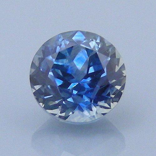 "A ""Ceylon Blue"" sapphire from Montana. This gemstone listing makes a clear distinction between the color name and the origin of the stone. ""Sapphire,"" 1.04 cts., fancy round brilliant cut. © Dan Stairs Custom Gemstones. Used with permission."