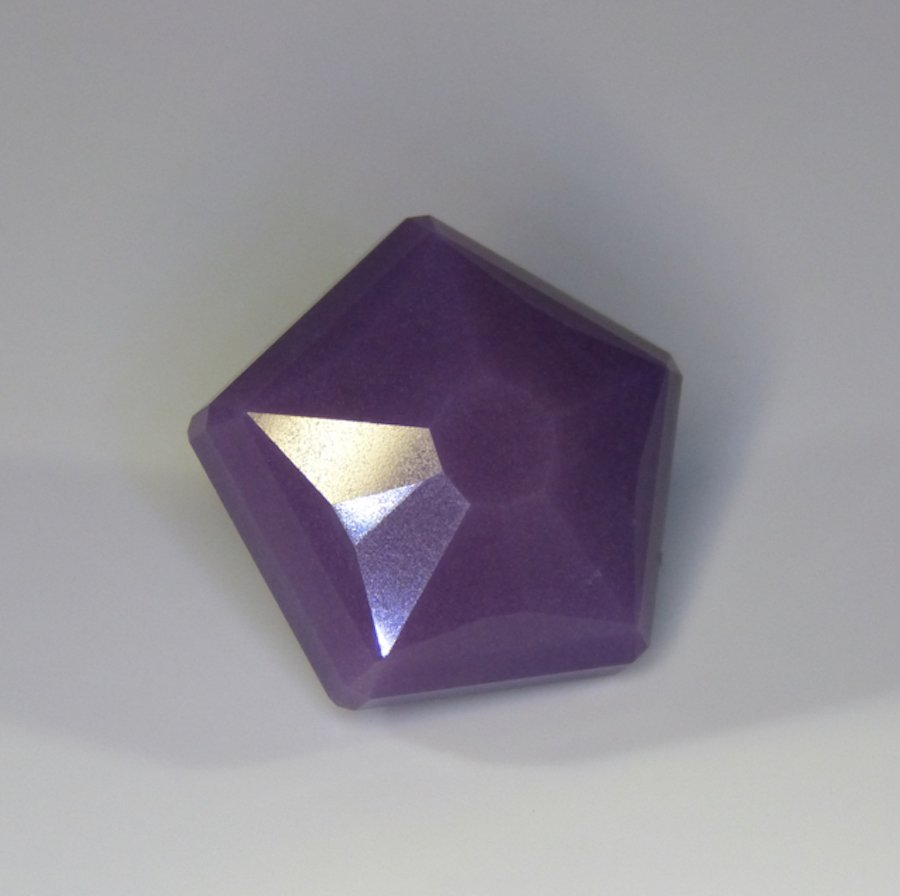 faceted sugilite by Mark Oros