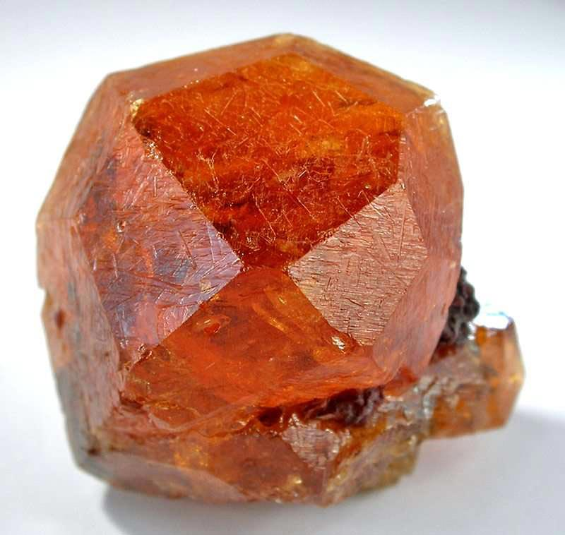 """Spessartine Garnet,"" mandarin orange crystal, Loliondo, near Serengeti National Park, Tanzania. © Rob Lavinsky, www.iRocks.com. Used with permission."
