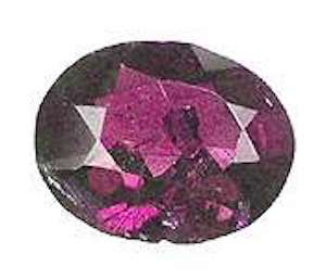 oval-cut alexandrite - incandescent light