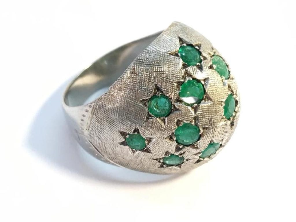 bombe ring with chipped emerald