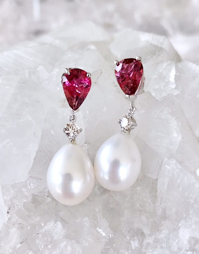 pearl earrings - pearl symbolism