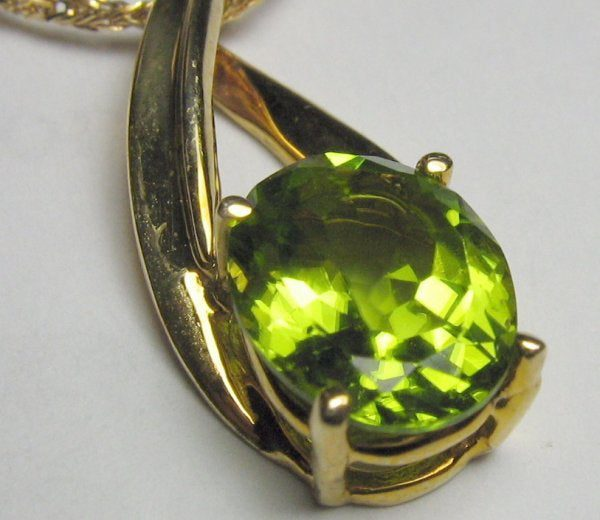 synthetic peridot in gold necklace