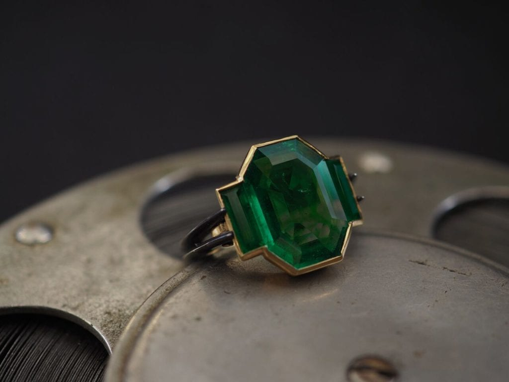 old mine emerald in a modern ring - emerald buying guide