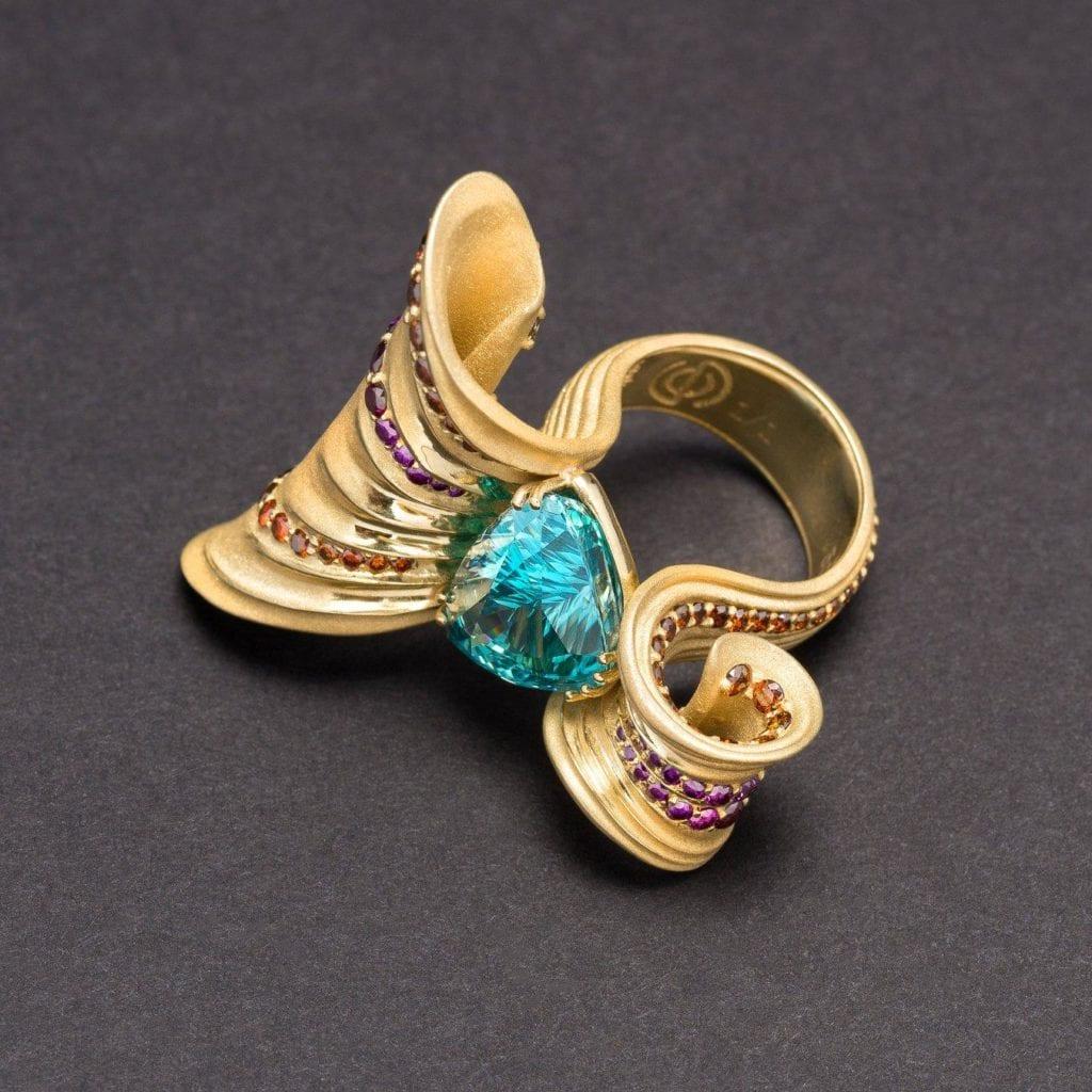 zircon buying - blue zircon ring with purple and orange diamonds