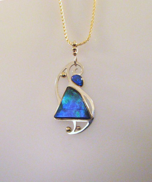 ammolite buying guide - blue ammolite pendant