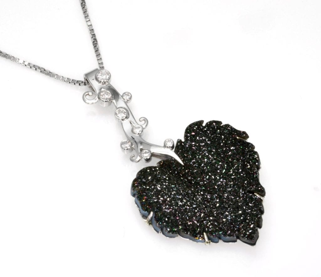 raw stone jewelry design and care - black druzy leaf
