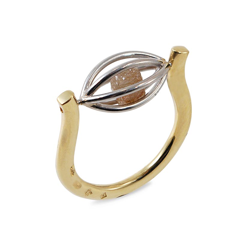 raw stone jewelry design and care - tension cage ring