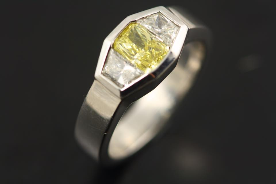 yellow gemstones - fancy intense yellow diamond ring