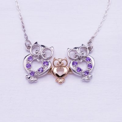 amethyst pendant with owl motif