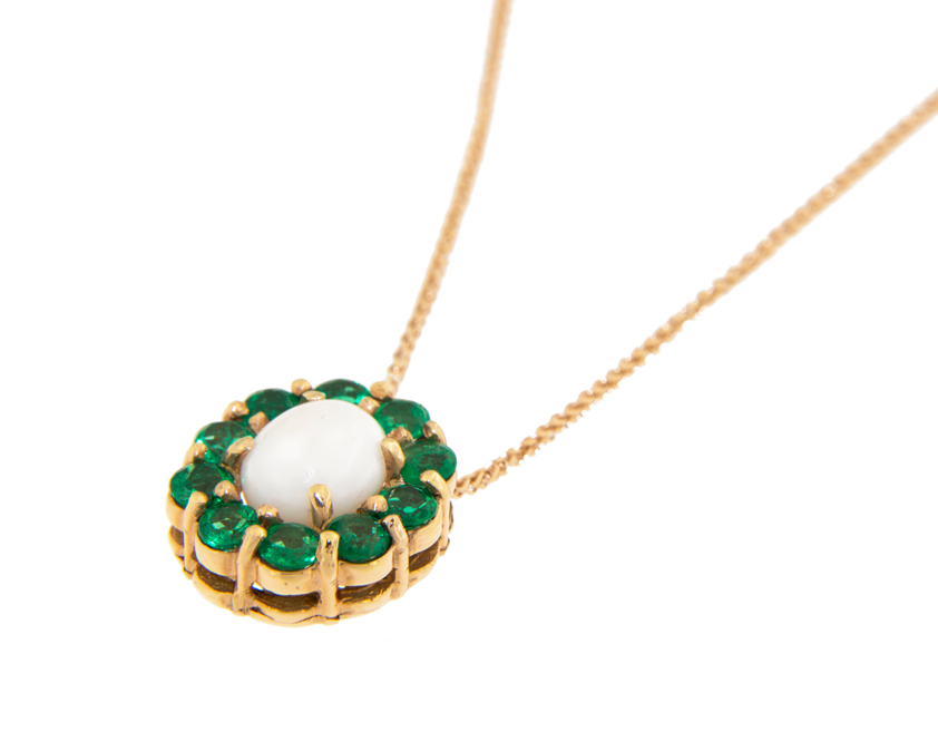 conch pearl buying guide - white conch pearl and emerald pendant