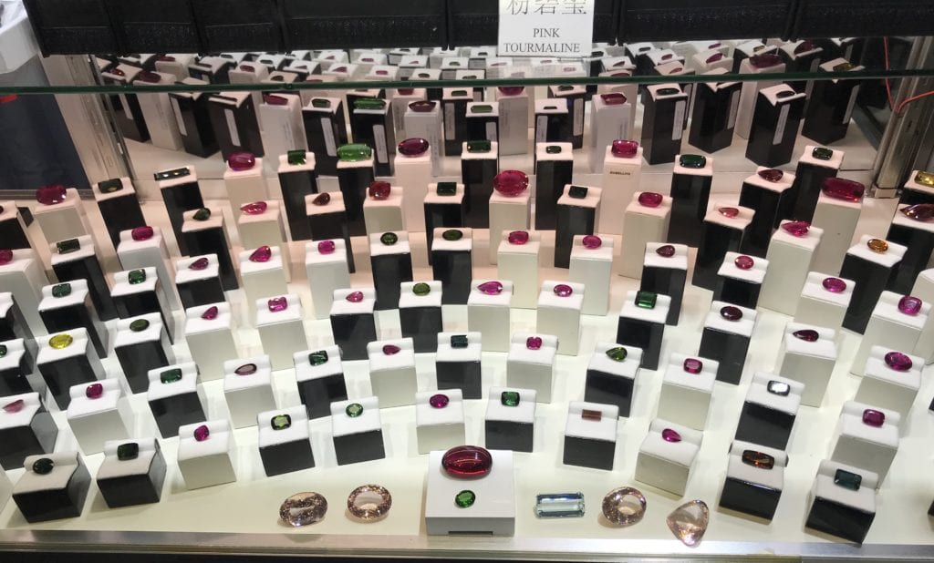 Tucson display of tourmalines - diamond cost