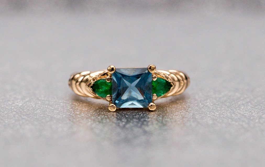 London Blue topaz engagement ring with emerald accents