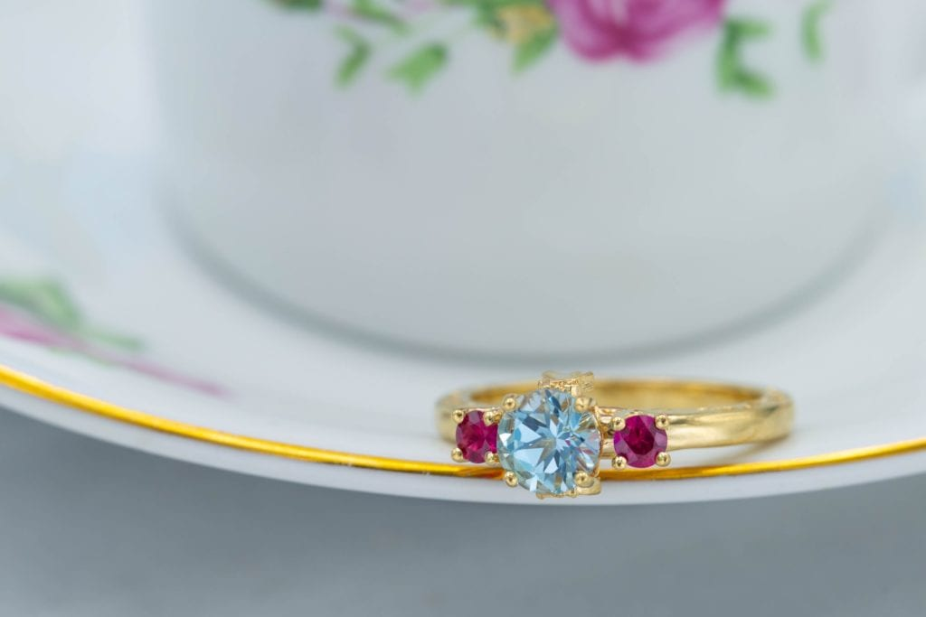 sky blue topaz engagement ring with ruby accents
