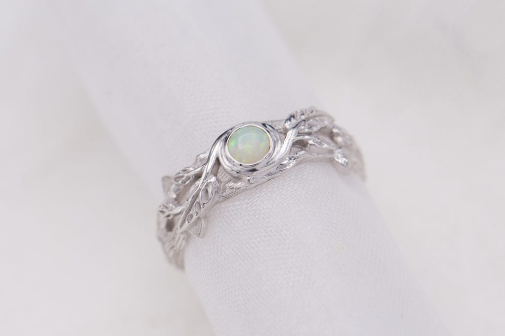white opal in nature-inspired ring - opal engagement ring stone
