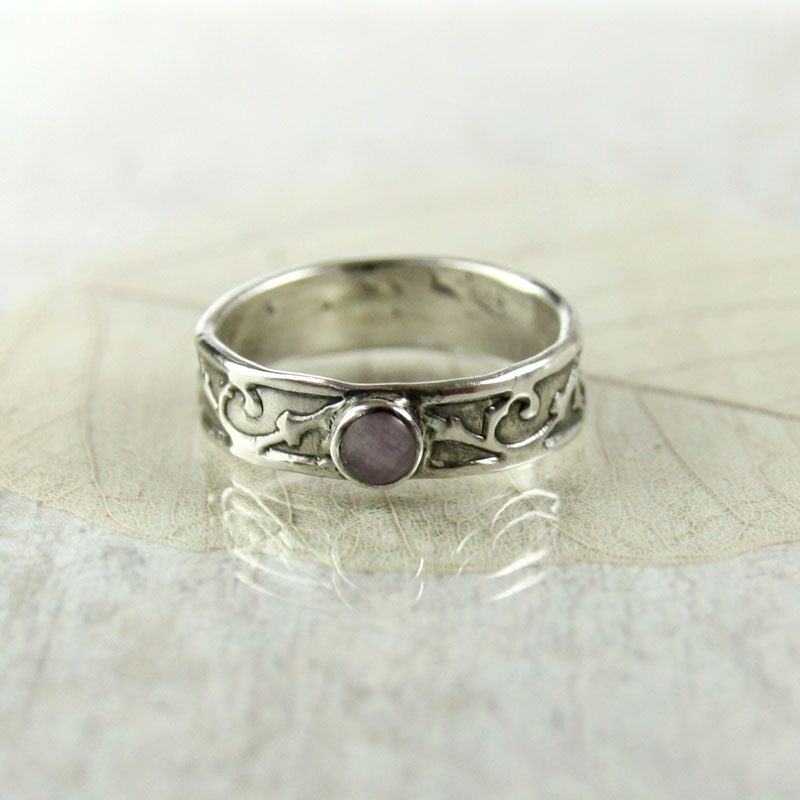 victorian-style ring with bezel-set amethyst - protective gem settings