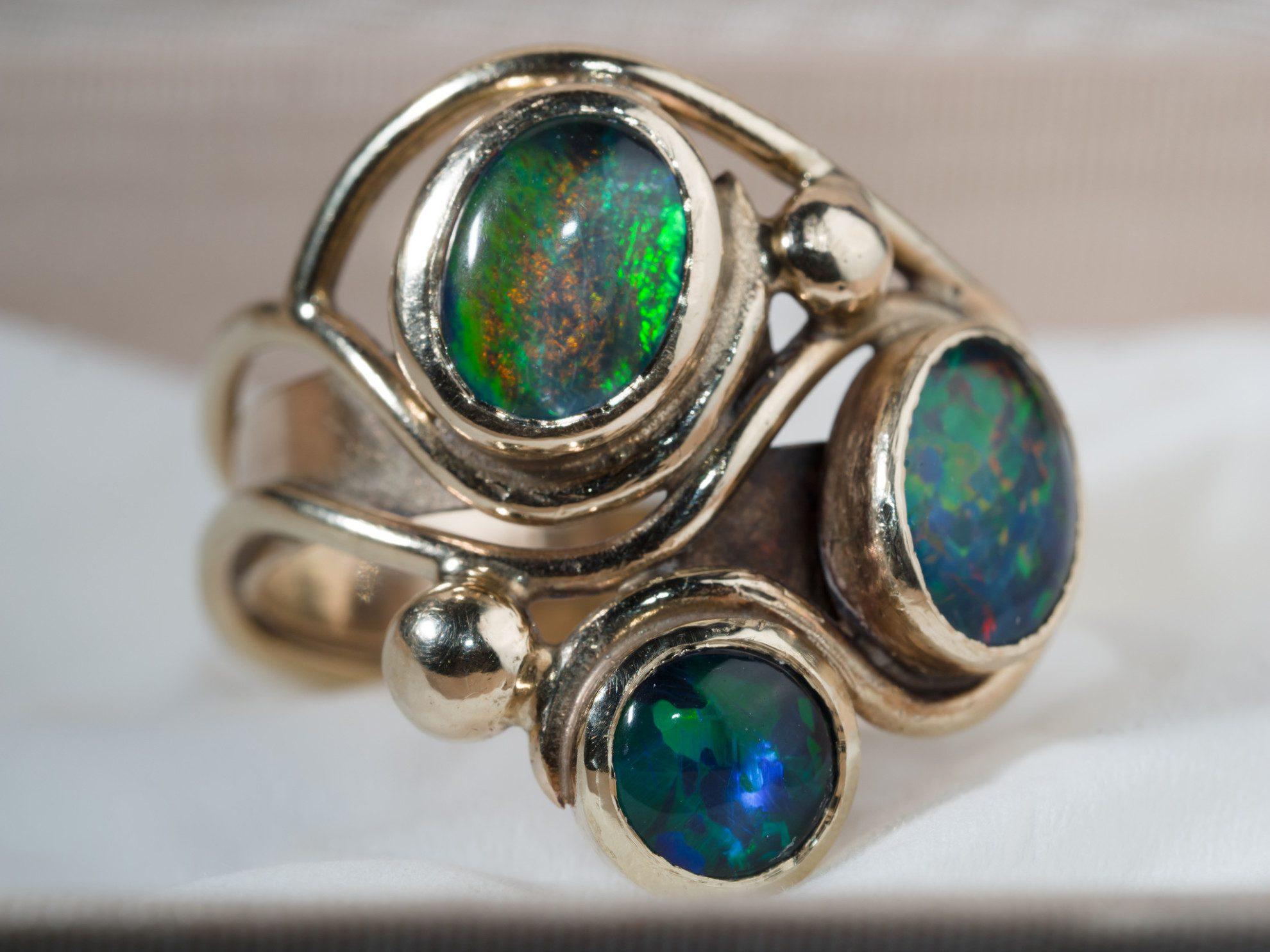 bezel-set opals - protective gem settings