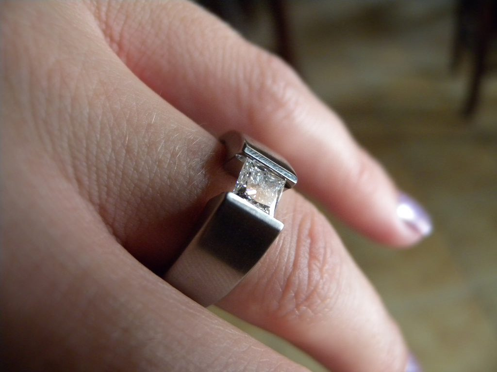 titanium engagement ring with tension-set diamond - protective gem settings