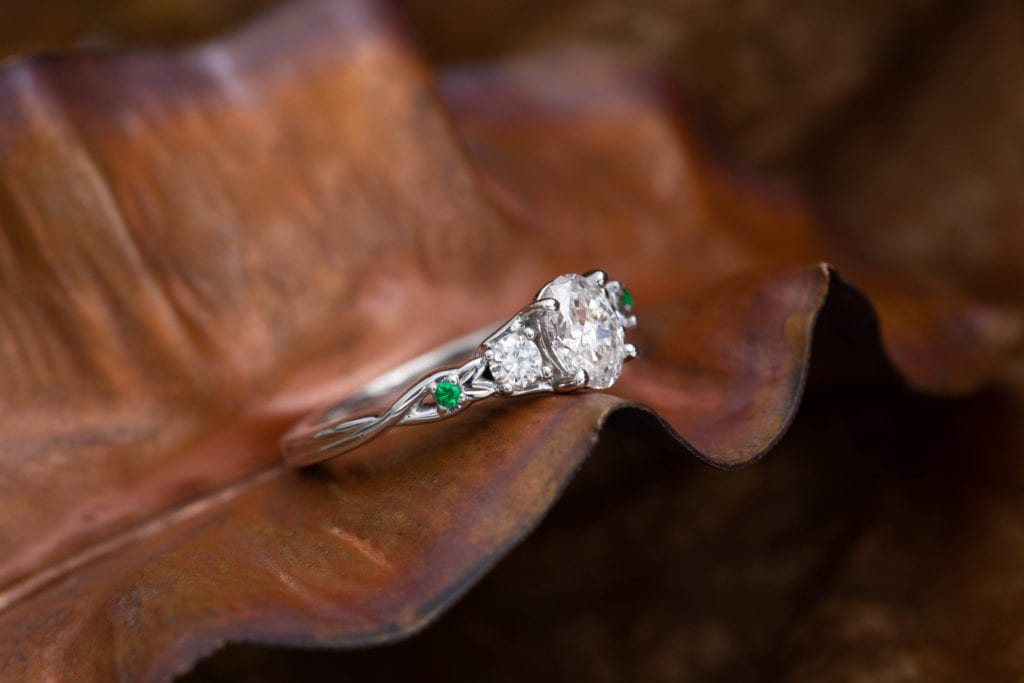 oval-cut diamond guide - ring with emerald accents