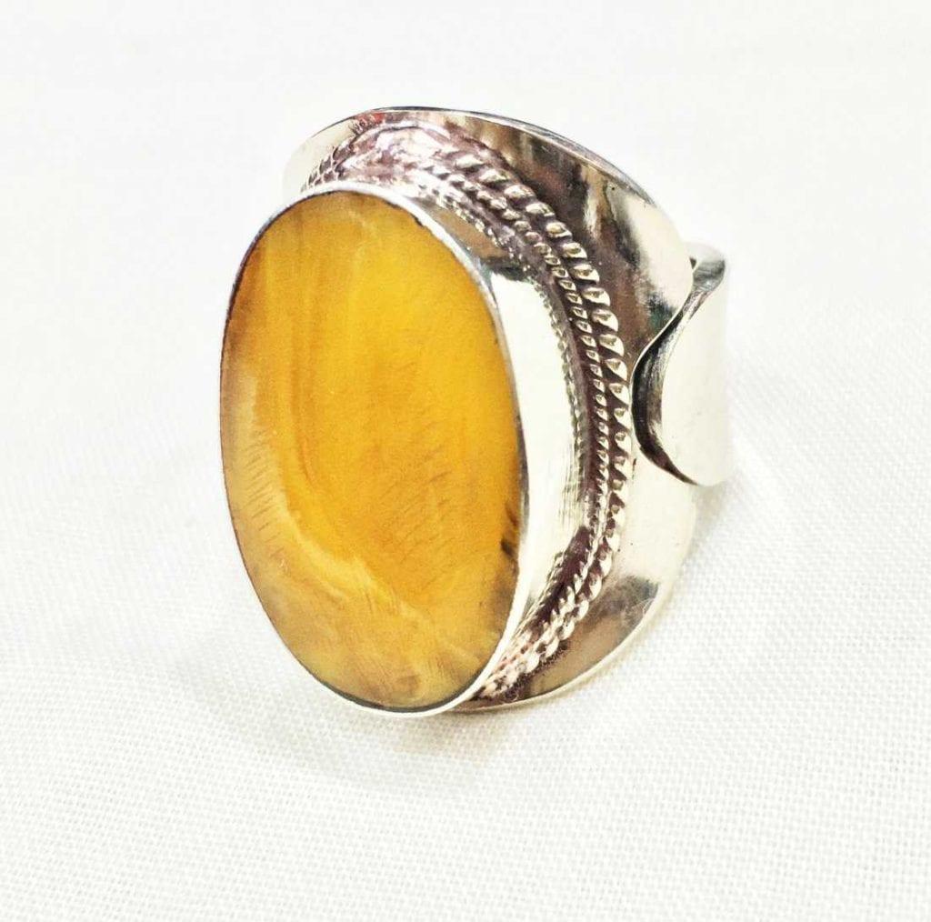 bezel-set amber ring - protective gem settings