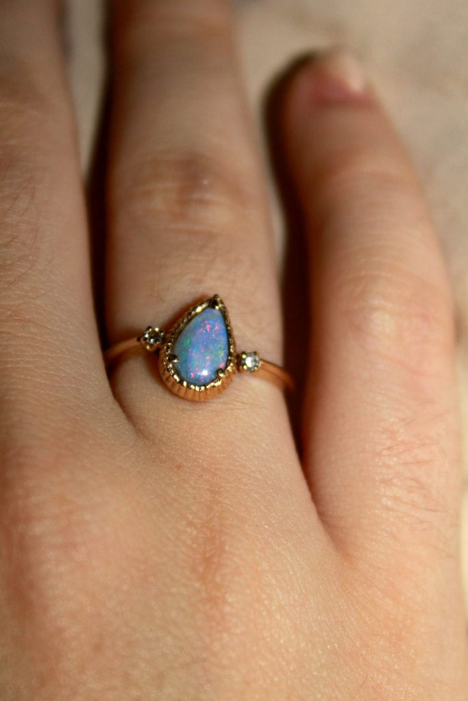 bezel-set opal ring with raised prongs - protective gem settings