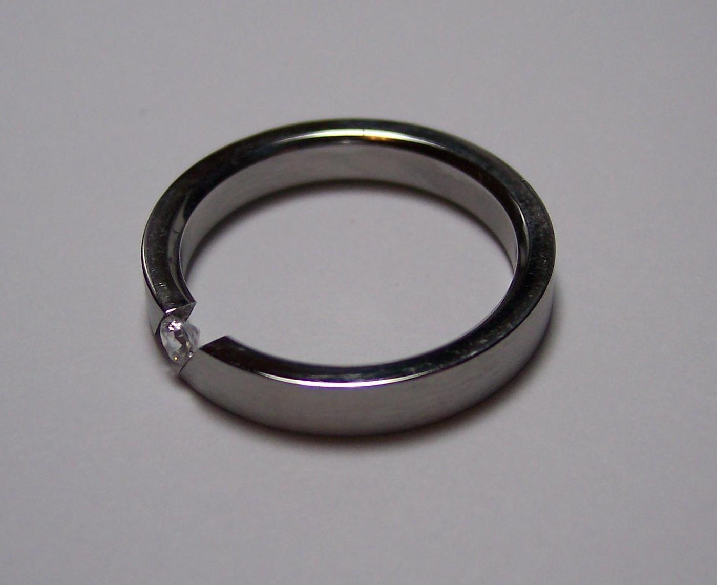 tension-set diamond ring - protective gem settings