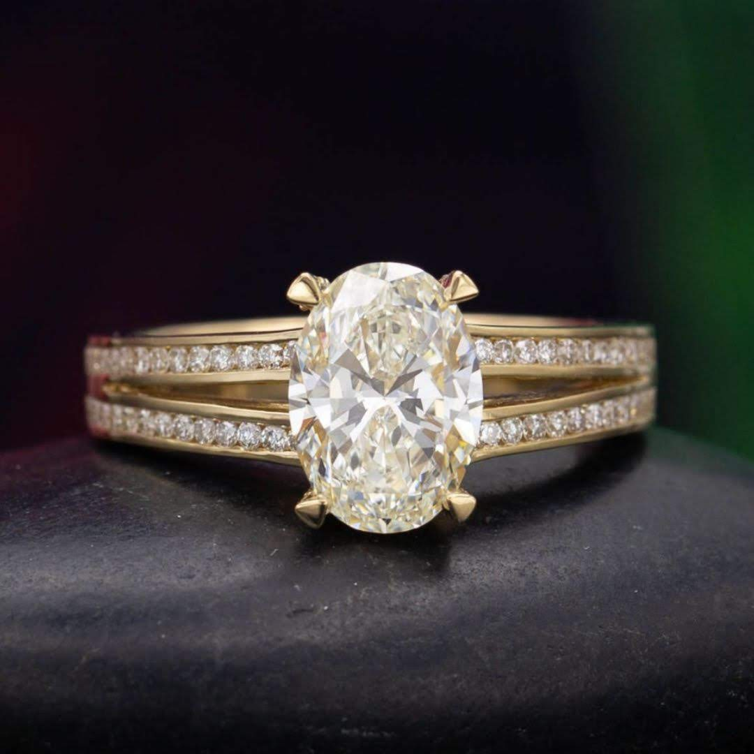 diamond shape - oval diamond set in a split shank engagement ring