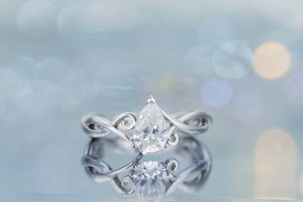 diamond shape - pear cut diamond engagement ring with vining