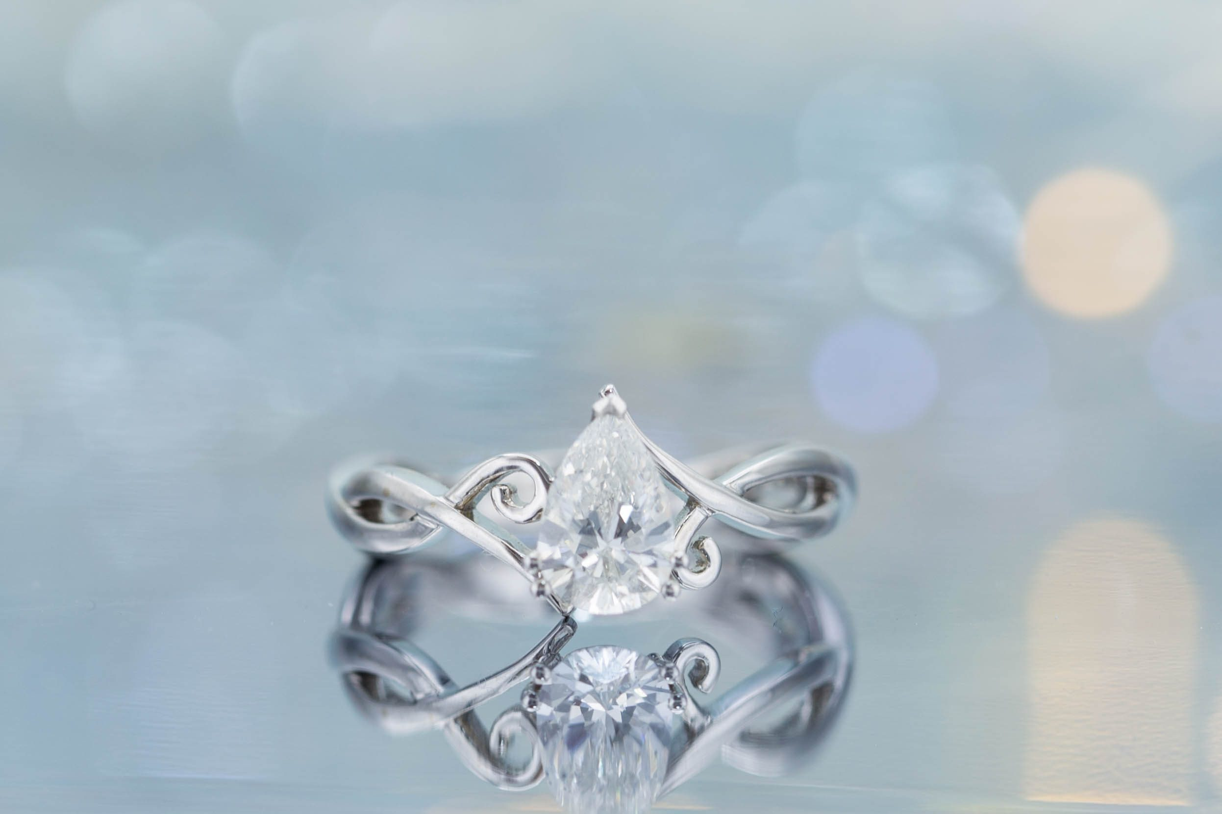 diamond shape - pear cut diamond engagement ring with vining