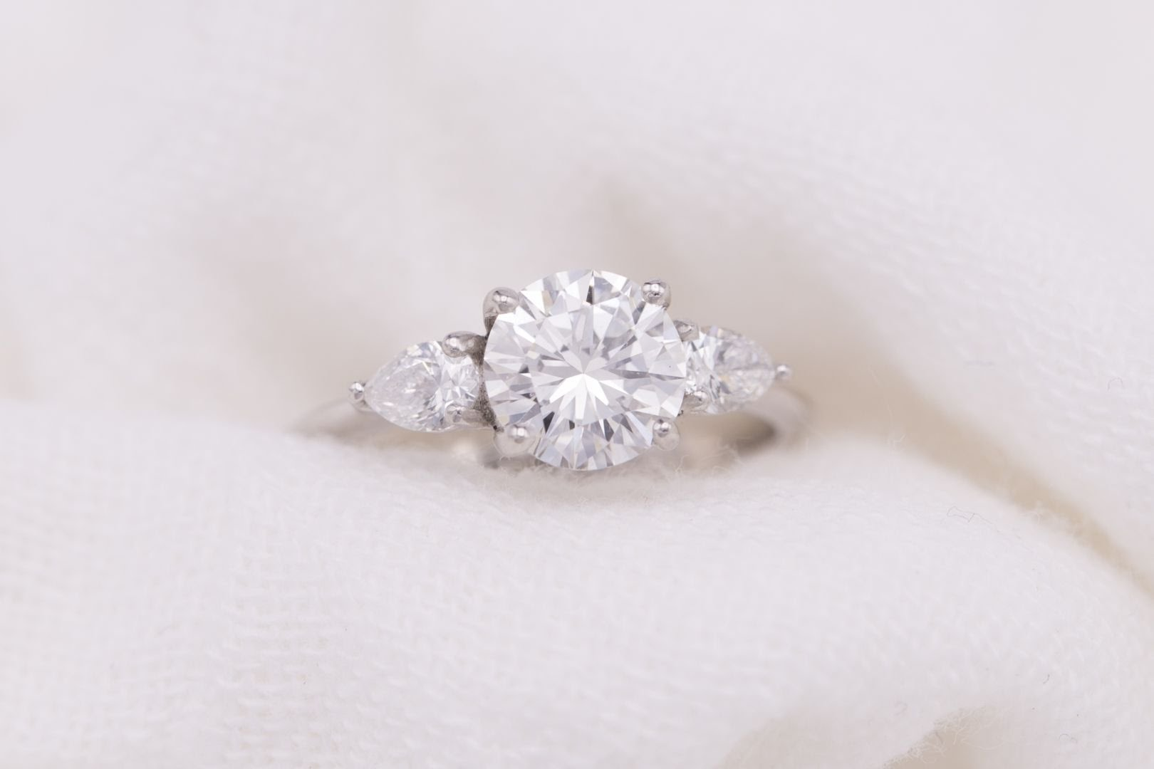 buying a one carat diamond ring - three-stone ring with pear side stones