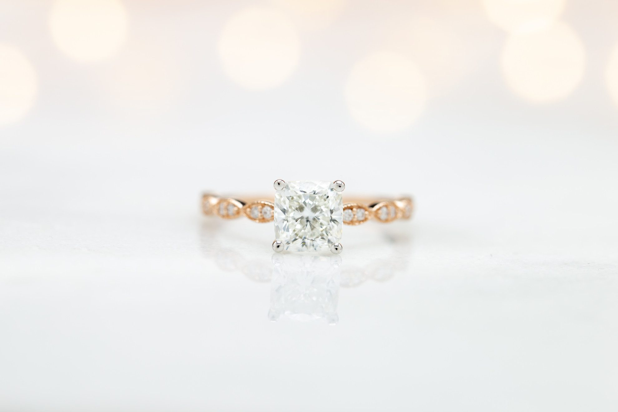 cushion-cut diamonds - solitaire engagement ring in white and rose gold