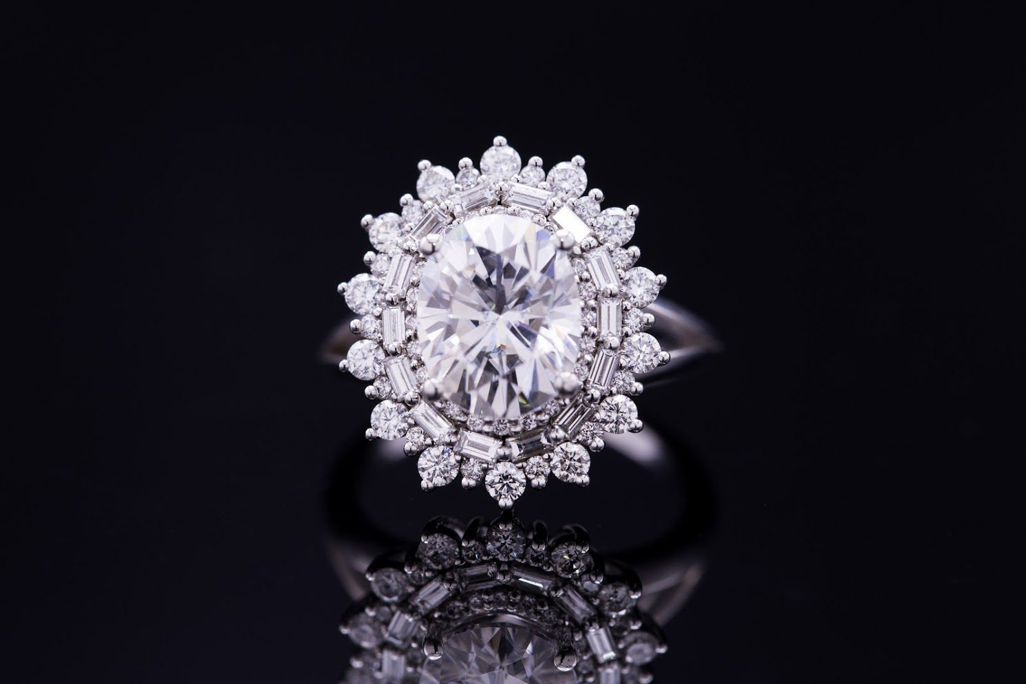 five-carat diamond - moissanite oval engagement ring