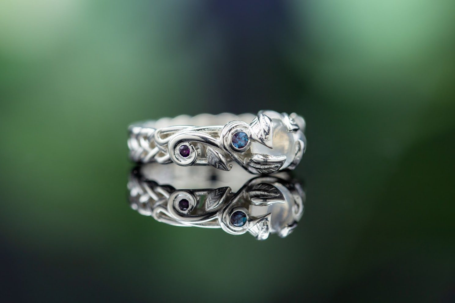 engagement ring settings - decorative leaf prongs on a moonstone
