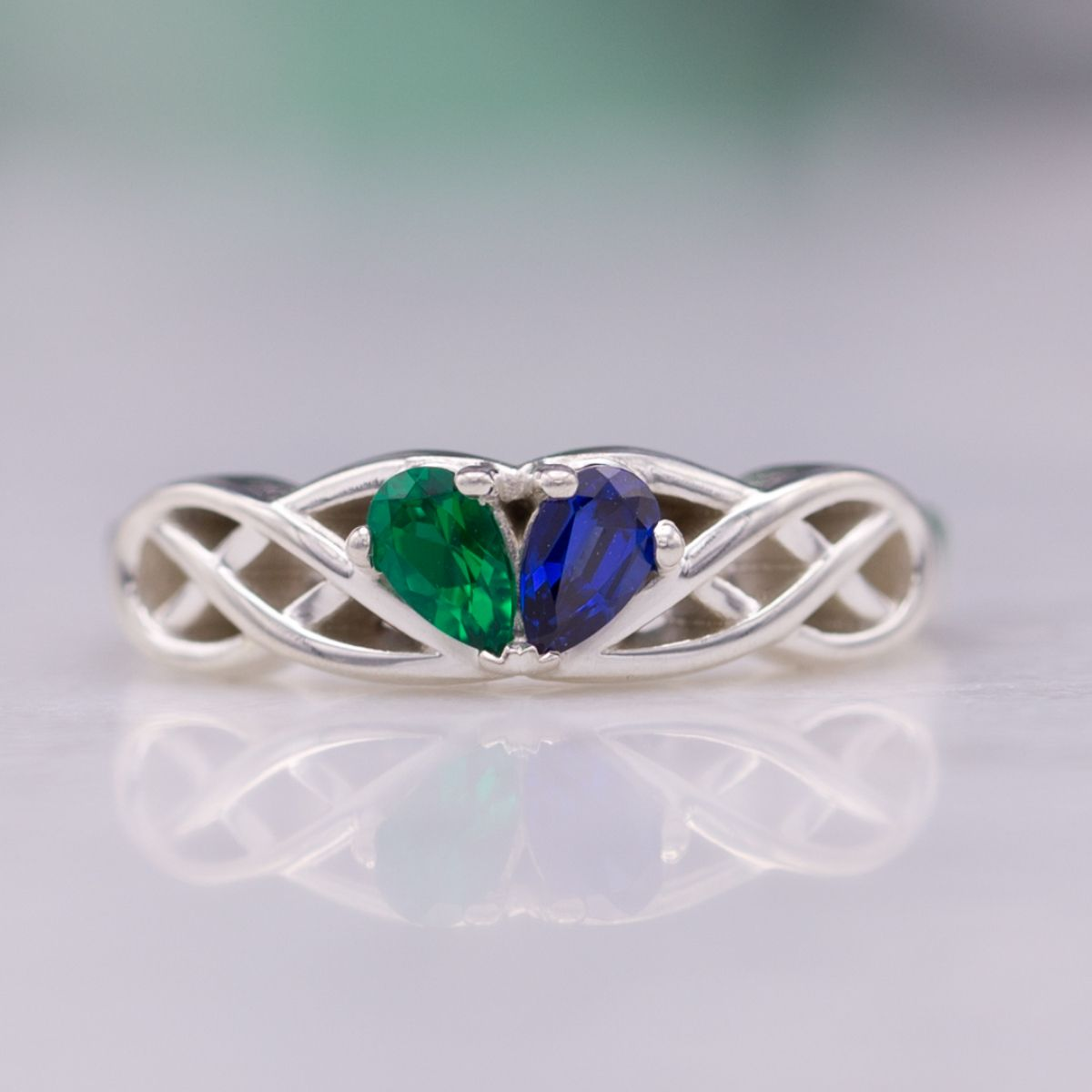 two-stone emerald and sapphire - engagement ring setting