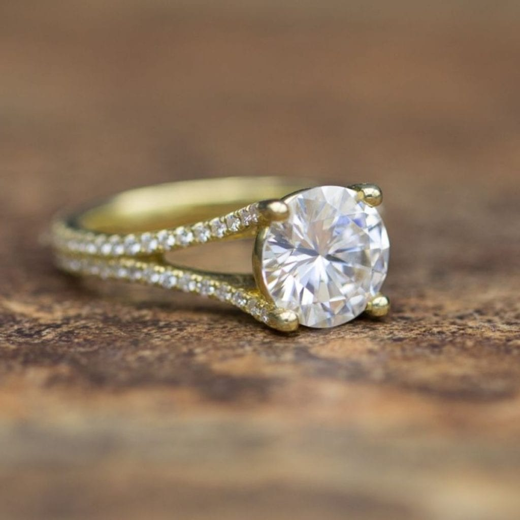 moissanite vs diamond - yellow gold pave split shank engagement ring with large moissanite