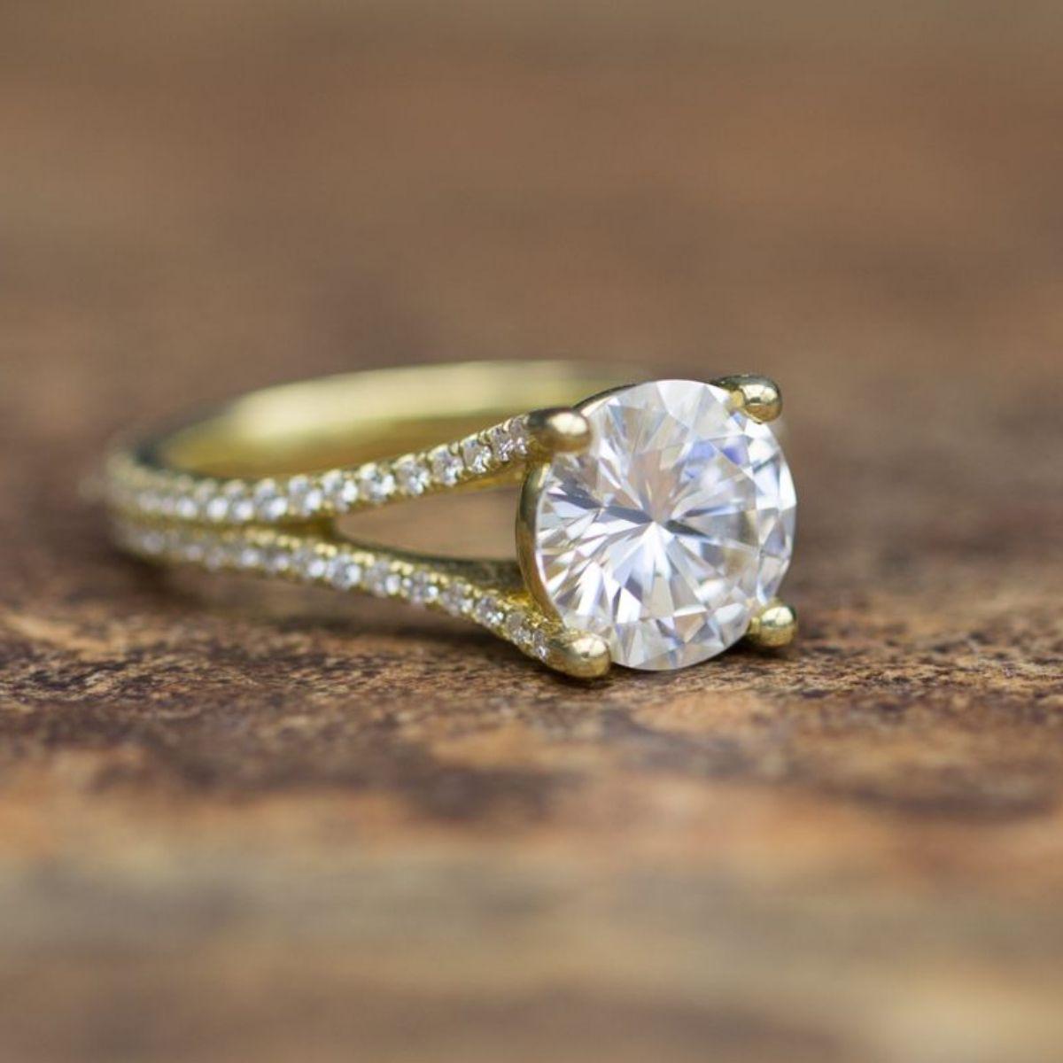 moissanite vs diamond - yellow gold pave split shank engagement ring with large moissanite