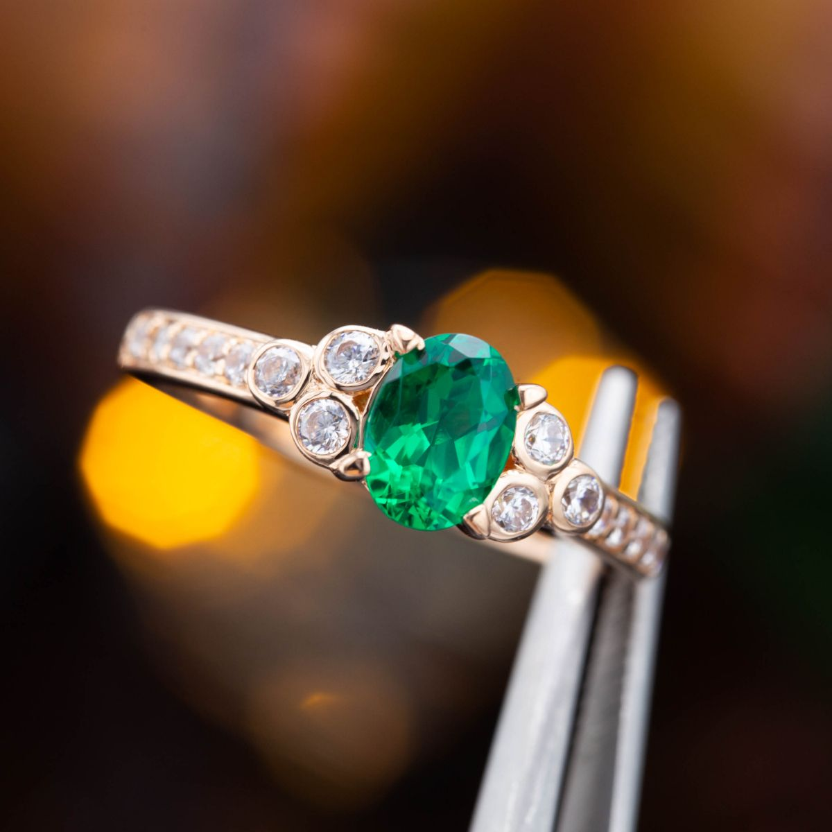 oval-cut emerald side stone - engagement ring setting