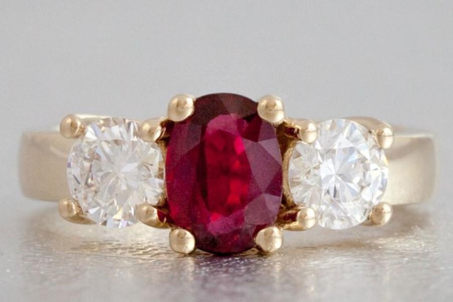 Ruby and Diamond Three-Stone Halo Engagement Ring