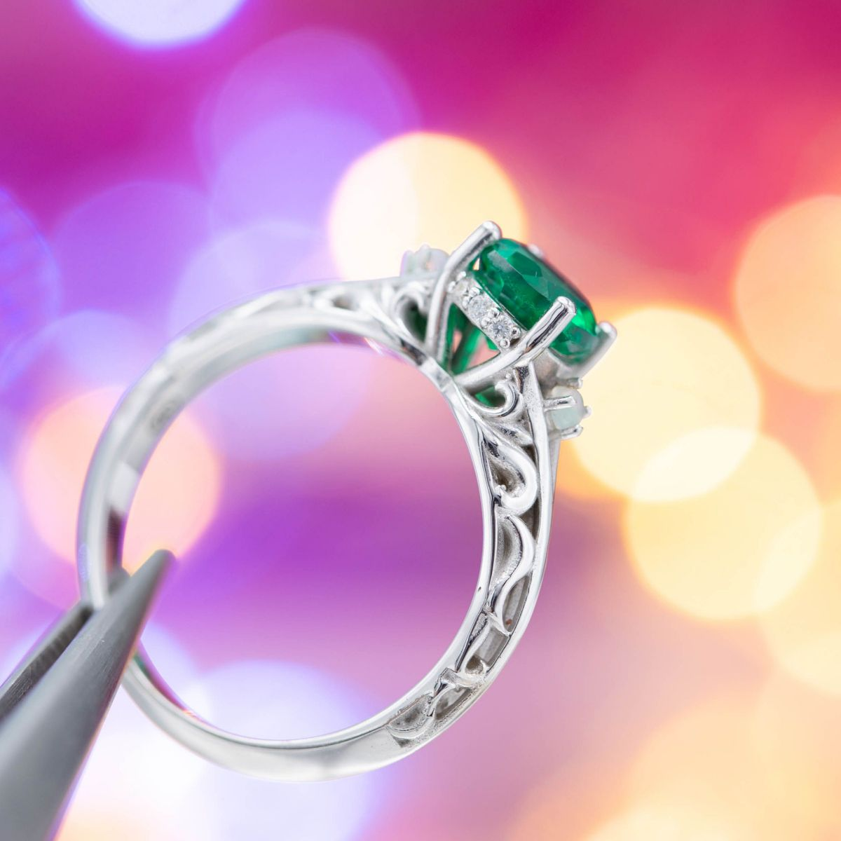 emerald with scrolling - engagement ring setting