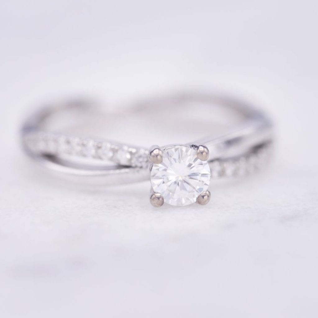 moissanite vs diamond - moissanite engagement ring twisting pave band