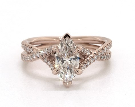 twisting shank engagement ring - marquise-cut diamonds