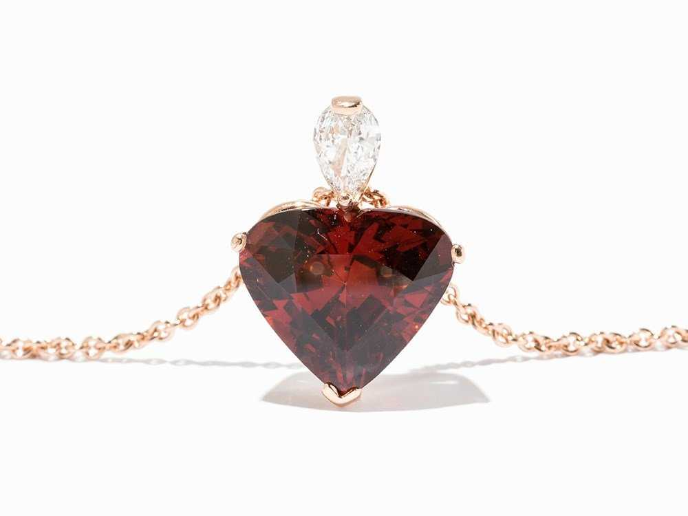 heart-cut spessartine garnet and diamond pendant - garnet symbolism and legends