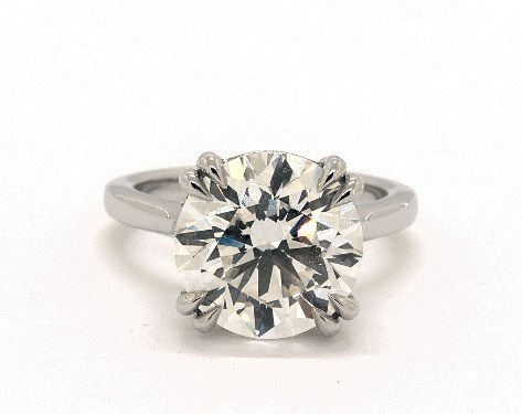 5.06ct solitaire engagement ring - what carat diamond should I get